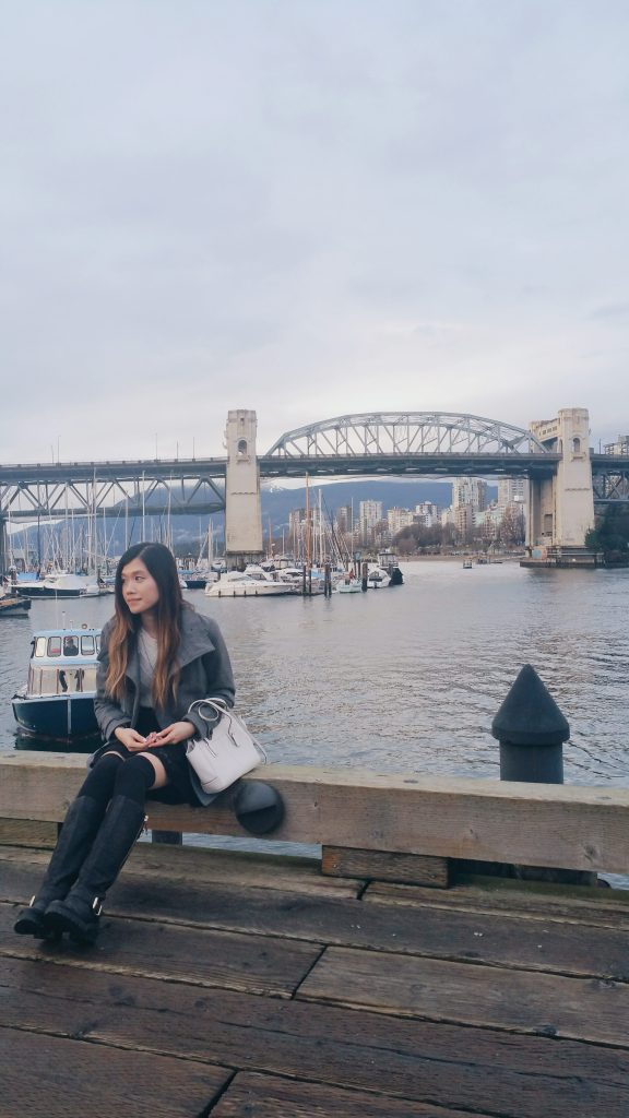 Just chilling at Granville Island - check out the beautiful scene behind me