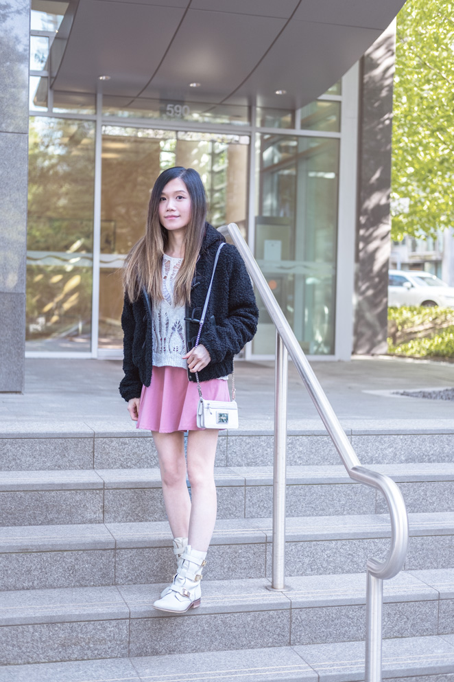 black furry jacket, pink skirt, white boots, crossbody wallet