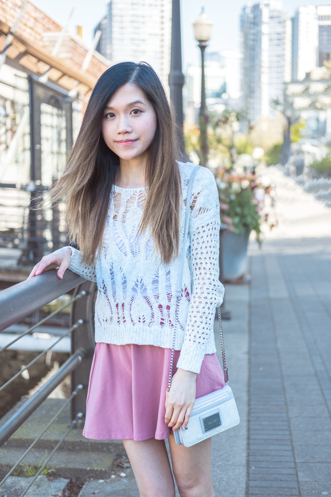 white crochet sweater, pink skirt, crossbody wallet