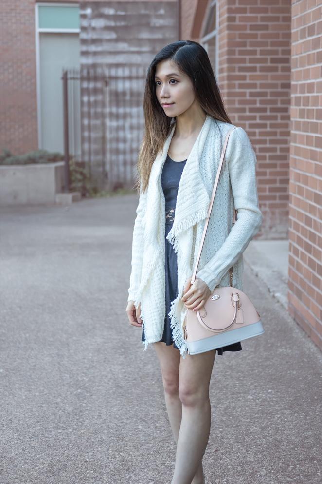 white blanket cardigan, pink Coach bag